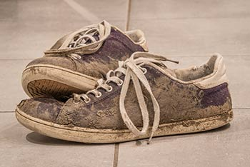 Des chaussures couvertes de boueé